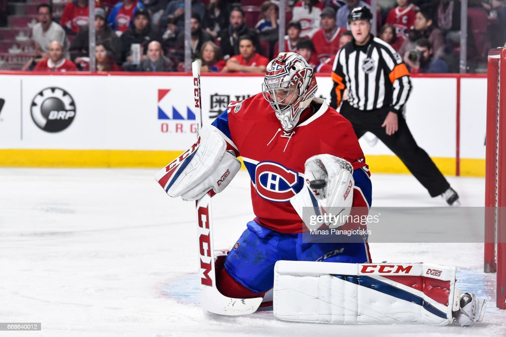 Carey Price #31 of the Montreal Canadiens makes a glove save against the New York Rangers in Game Two of the Eastern Conference First Round during the 2017 NHL Stanley Cup Playoffs at the Bell Centre on April 14, 2017 in Montreal, Quebec, Canada.