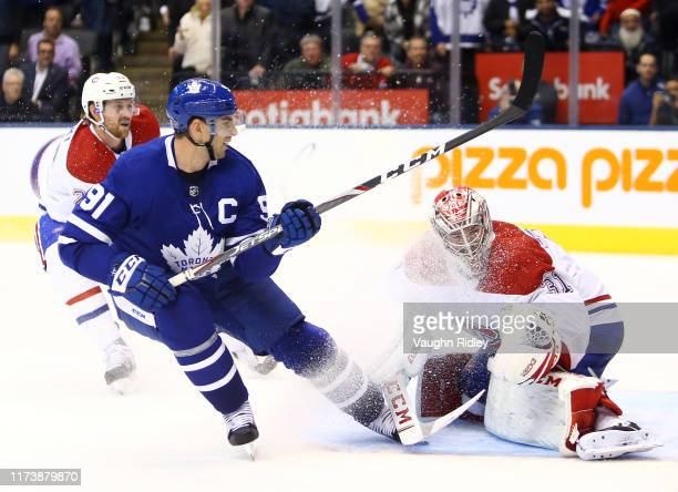 Carey Price of the Montreal Canadiens makes a glove save on John Tavares of the Toronto Maple Leafs in overtime during an NHL game at Scotiabank...