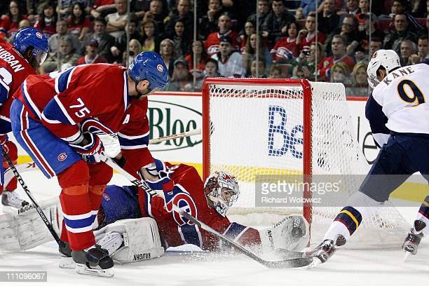 Carey Price of the Montreal Canadiens makes a glove save on the puck on an attempt by Evander Kane of the Atlanta Thrashers during the NHL game at...