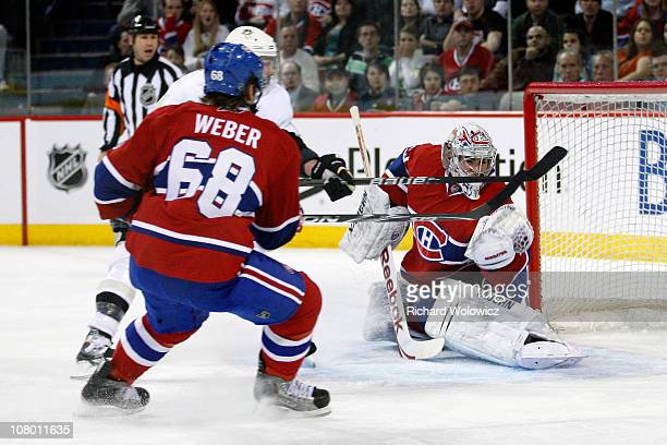Carey Price of the Montreal Canadiens makes a glove saves the puck on an attempt by Pascal Dupuis of the Pittsburgh Penguins during the NHL game at...