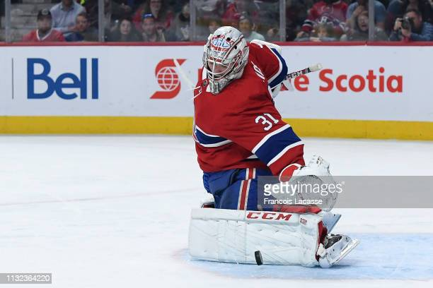 Carey Price of the Montreal Canadiens makes a kick save against the Buffalo Sabres in the NHL game at the Bell Centre on March 23 2019 in Montreal...