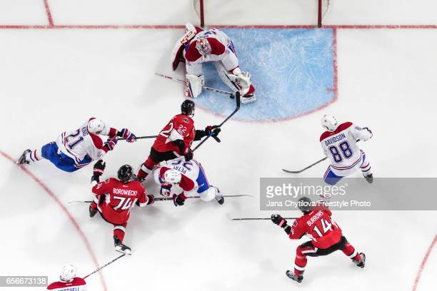 Carey Price of the Montreal Canadiens makes a pad save against Chris Kelly of the Ottawa Senators as Mark Borowiecki and Alexandre Burrows of the...