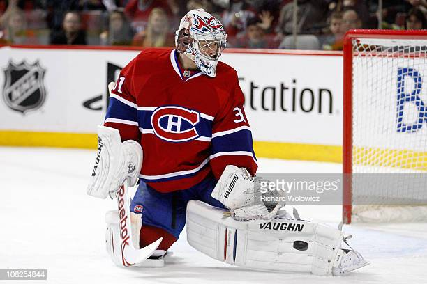 Carey Price of the Montreal Canadiens makes a pad save on the puck in overtime on a shot by Bobby Ryan of the Anaheim Ducks during the NHL game at...