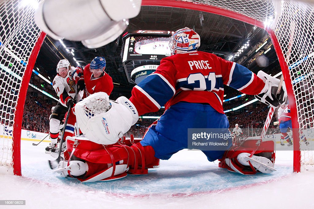 Carey Price #31 of the Montreal Canadiens makes a pad save on the puck on an attempt by Daniel Alfredsson #11 of the Ottawa Senators during the NHL game at the Bell Centre on February 3, 2013 in Montreal, Quebec, Canada. The Canadiens defeated the Senators 2-1.