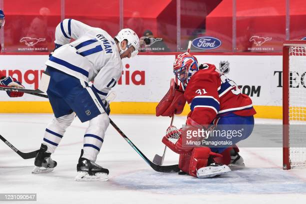 Carey Price of the Montreal Canadiens makes a pad save on Zach Hyman of the Toronto Maple Leafs during the first period at the Bell Centre on...