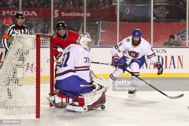 Carey Price of the Montreal Canadiens makes a pad save with with teammate Jordie Benn and Matt Duchene of the Ottawa Senators battling in front...