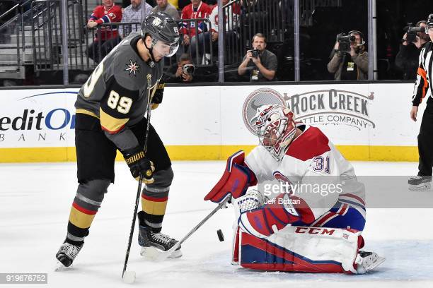 Carey Price of the Montreal Canadiens makes a save against Alex Tuch of the Vegas Golden Knights during the game at TMobile Arena on February 17 2018...
