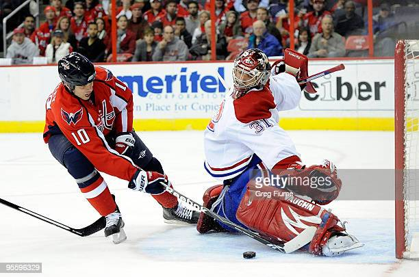 Carey Price of the Montreal Canadiens makes a save against Matt Bradley of the Washington Capitals at the Verizon Center on January 5, 2010 in...