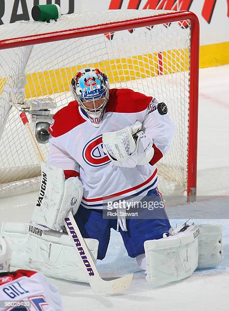 Carey Price of the Montreal Canadiens makes a save against the Buffalo Sabres at HSBC Arena on March 24 2010 in Buffalo New York