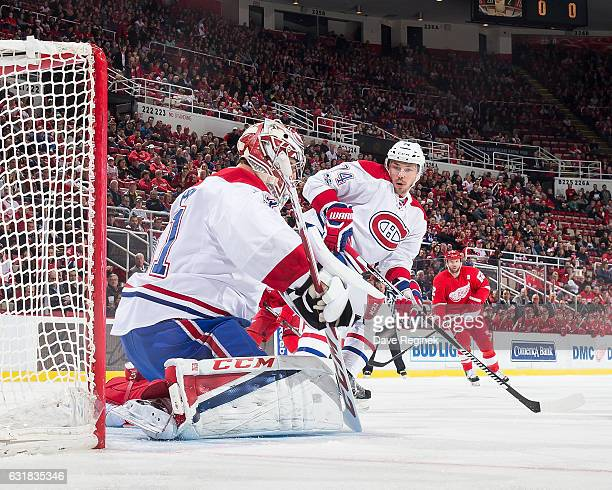 Carey Price of the Montreal Canadiens makes a save as teammate Alexei Emelin skates in for the rebound during an NHL game against the Detroit Red...