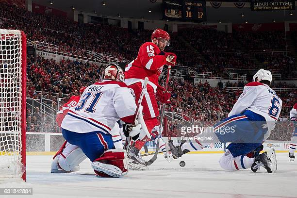 Carey Price of the Montreal Canadiens makes a save as teammate Shea Weber battles for the rebound with Riley Sheahan of the Detroit Red Wings during...