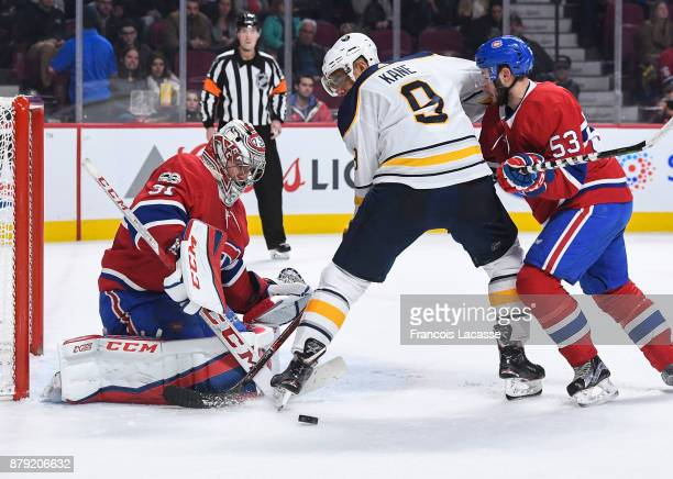 Carey Price of the Montreal Canadiens makes a save in front of Evander Kane of the Buffalo Sabres in the NHL game at the Bell Centre on November 25...