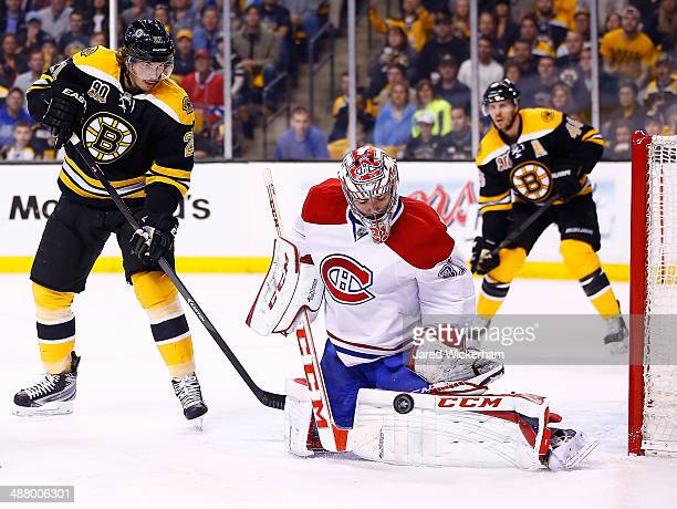 Carey Price of the Montreal Canadiens makes a save in front of Loui Eriksson of the Boston Bruins in the first period in Game Two of the Second Round...