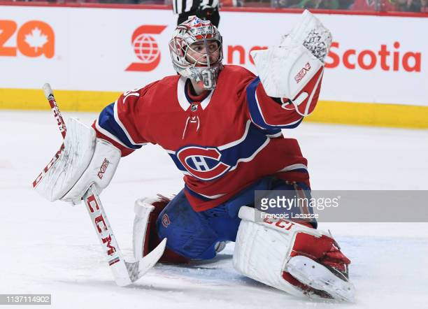 Carey Price of the Montreal Canadiens makes a save off the shot by the Chicago Blackhawks in the NHL game at the Bell Centre on March 16 2019 in...