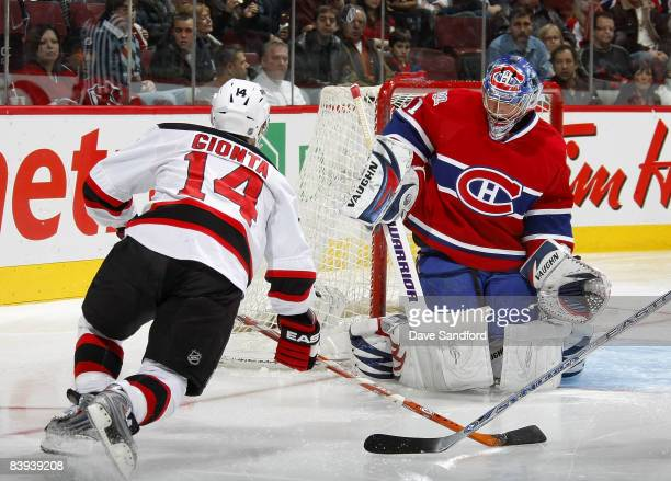 Carey Price of the Montreal Canadiens makes a save on Brian Gionta of the New Jersey Devils during their NHL game at the Bell Centre December 6 2008...