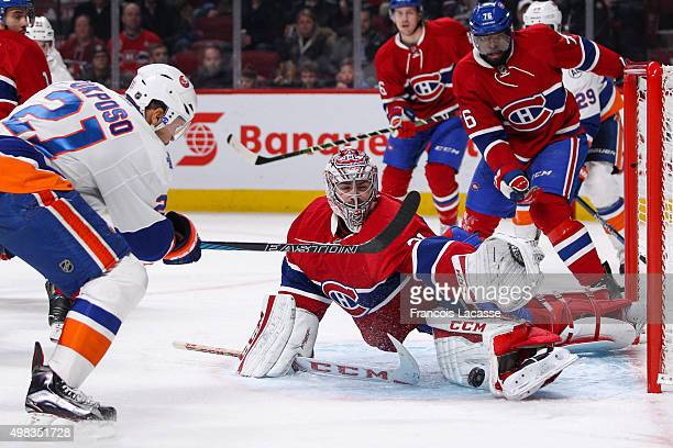 Carey Price of the Montreal Canadiens makes a save on Kyle Okposo of the New York Islanders in the NHL game at the Bell Centre on November 22 2015 in...