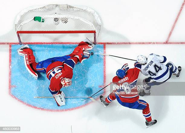 Carey Price of the Montreal Canadiens makes a save on Nate Thompson of the Tampa Bay Lightning during the NHL game on November 12 2013 at the Bell...