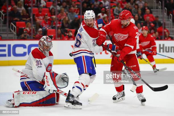 Carey Price of the Montreal Canadiens makes a second period save behind teammate Jeff Petry and Tomas Tatar of the Detroit Red Wings at Little...