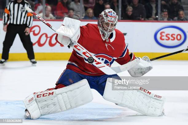 Carey Price of the Montreal Canadiens makes a stick save against the Florida Panthers in the NHL game at the Bell Centre on March 26 2019 in Montreal...