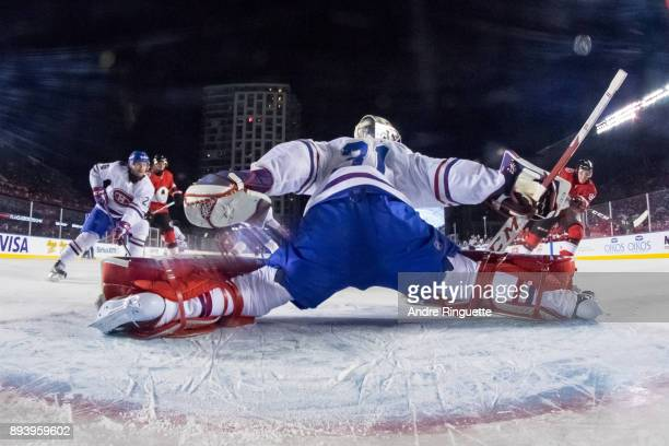 Carey Price of the Montreal Canadiens makes sprawling save against the Ottawa Senators during the 2017 Scotiabank NHL100 Classic at Lansdowne Park on...