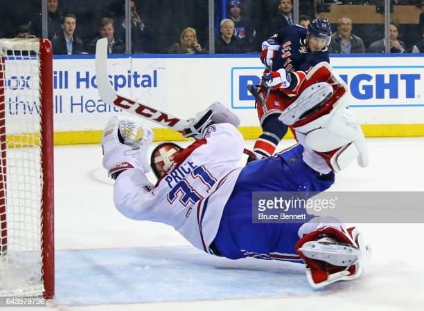 Carey Price of the Montreal Canadiens makes the diving save in the closing seconds of overtime against J.T. Miller of the New York Rangers at Madison...