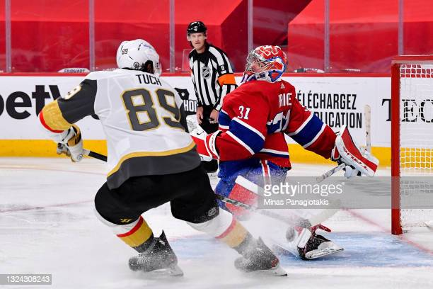 Carey Price of the Montreal Canadiens makes the save against Alex Tuch of the Vegas Golden Knights during the third period in Game Three of the...