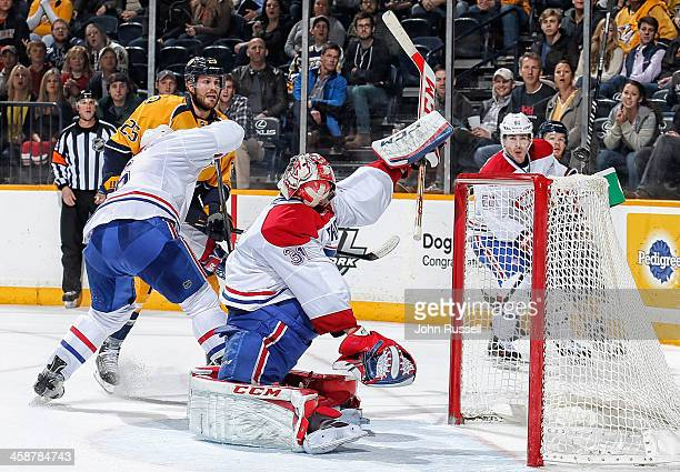Carey Price of the Montreal Canadiens makes the save against the Nashville Predators at Bridgestone Arena on December 21 2013 in Nashville Tennessee