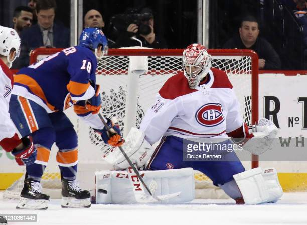 Carey Price of the Montreal Canadiens makes the save on Anthony Beauvillier of the New York Islanders at the Barclays Center on March 03, 2020 in the...