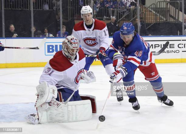 Carey Price of the Montreal Canadiens makes the second period save on Brendan Lemieux of the New York Rangers at Madison Square Garden on March 01...