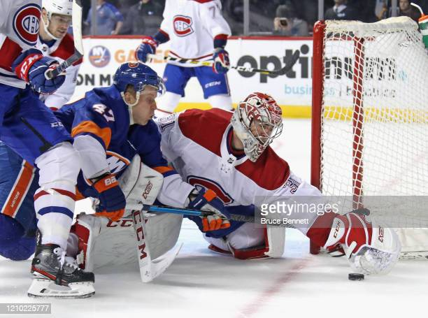 Carey Price of the Montreal Canadiens makes the second period save on Leo Komarov of the New York Islanders at the Barclays Center on March 03, 2020...