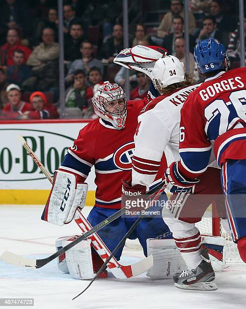 Carey Price of the Montreal Canadiens makes the third period save as Tim Kennedy of the Phoenix Coyotes looks for the rebound at the Bell Centre on...