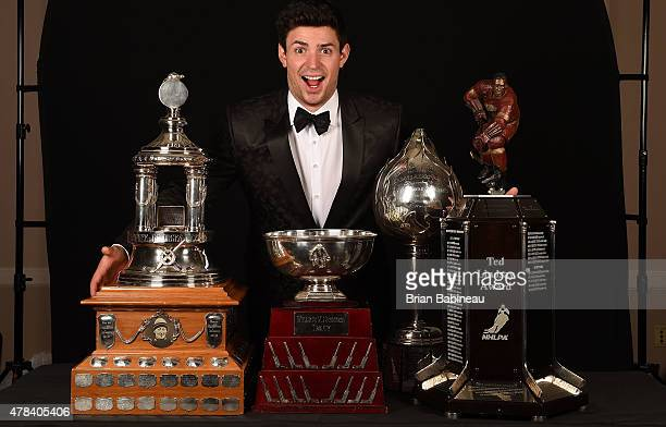 Carey Price of the Montreal Canadiens poses with the Vezina Trophy William M Jennings Trophy Hart Memorial Trophy and the Ted Lindsay Award during...