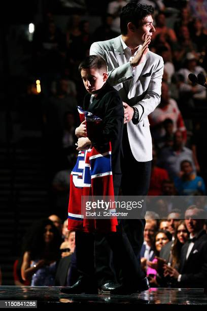 Carey Price of the Montreal Canadiens presents friend Anderson Whitehead a jersey and a trip to the 2020 NHL All-Star game during the the 2019 NHL...