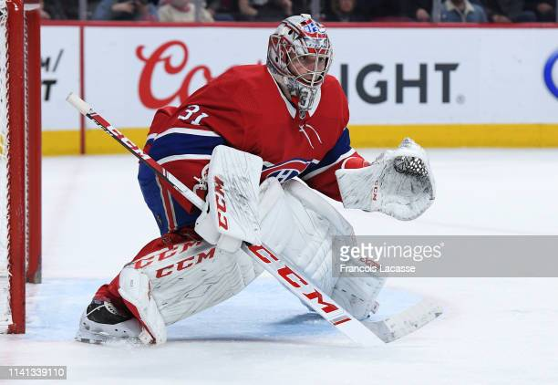 Carey Price of the Montreal Canadiens protects the goal against the Tampa Bay Lightning in the NHL game at the Bell Centre on April 2 2019 in...