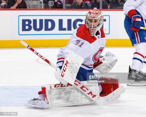 Carey Price of the Montreal Canadiens reacts to a shot during an NHL game against the Detroit Red Wings at Little Caesars Arena on February 18, 2020...