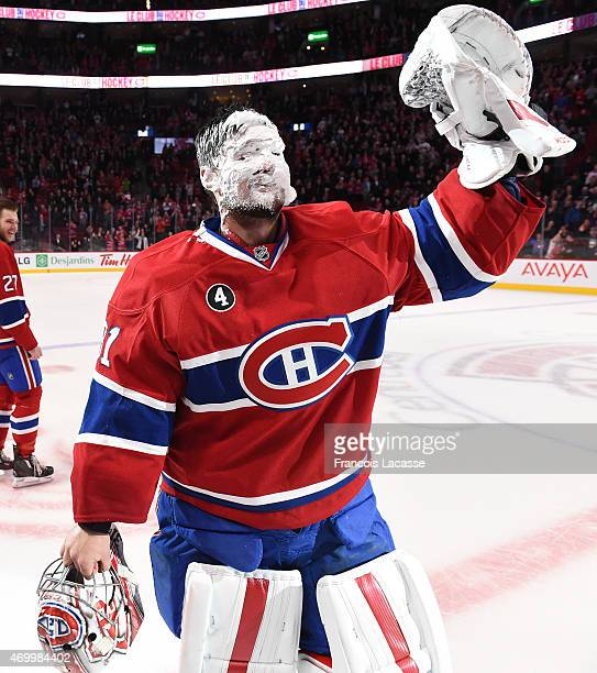 Carey Price of the Montreal Canadiens salutes the crowd after the team record at the end of the NHL game against Detroit Red Wings in the NHL game at...