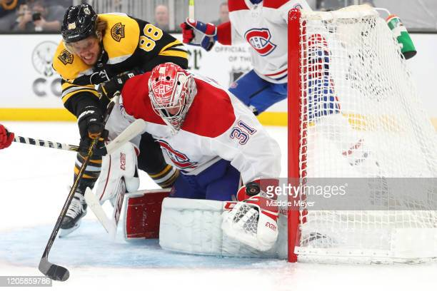 Carey Price of the Montreal Canadiens saves a shot from David Pastrnak of the Boston Bruins during the first period at TD Garden on February 12, 2020...