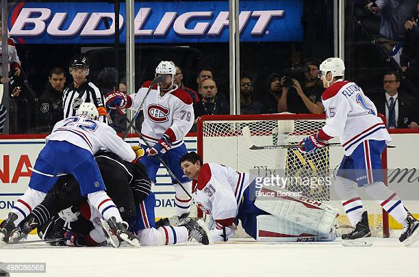 Carey Price of the Montreal Canadiens sits in the crease following a collision with Brock Nelson of the New York Islanders late in the third period...