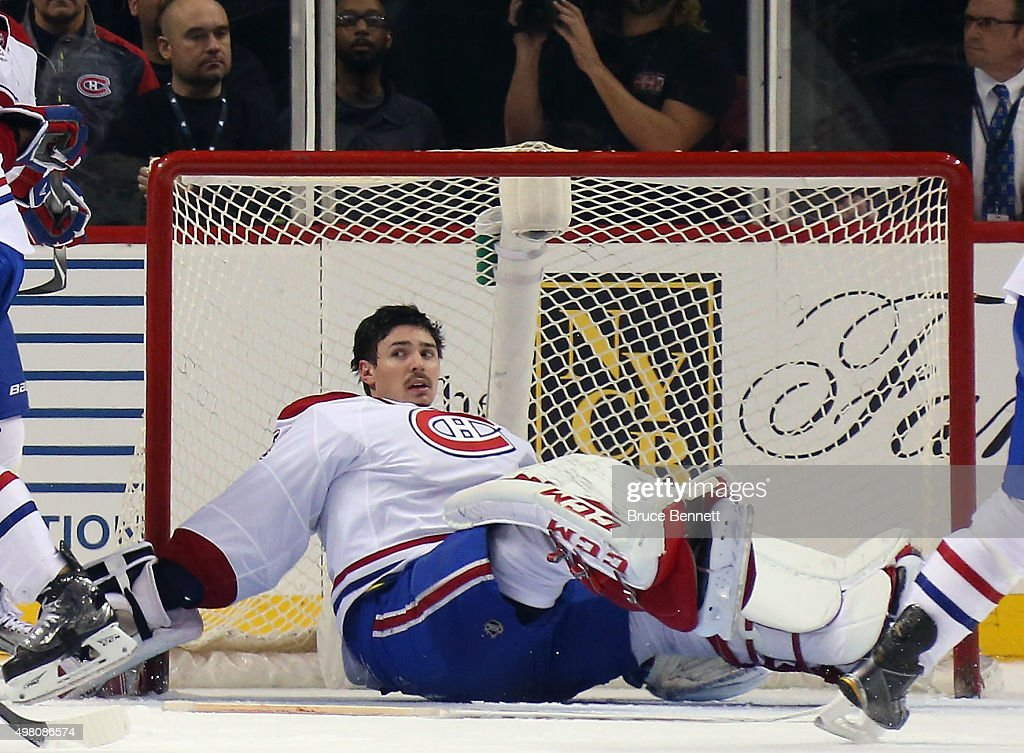 Carey Price #31 of the Montreal Canadiens sits in the crease following a collision with Brock Nelson #29 of the New York Islanders late in the third period at the Barclays Center on November 20, 2015 in the Brooklyn borough of New York City. The Canadiens defeated the Islanders 5-3.