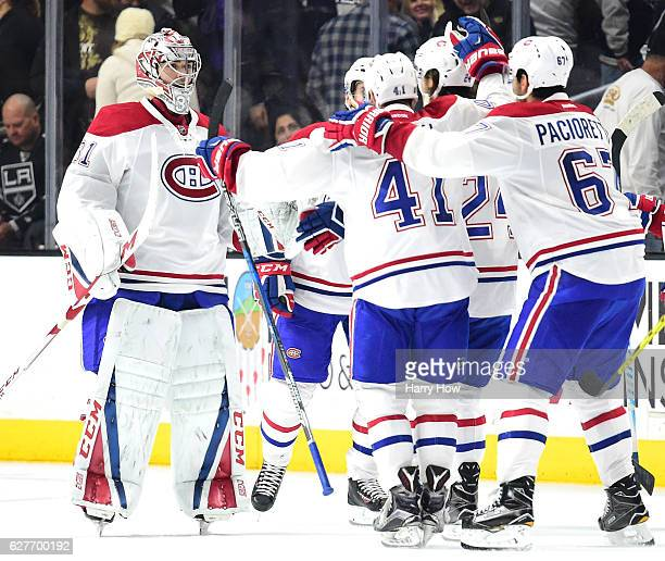 Carey Price of the Montreal Canadiens skates towards his teammates in celebration of a 5-4 sudden death overtime win over the Los Angeles Kings at...