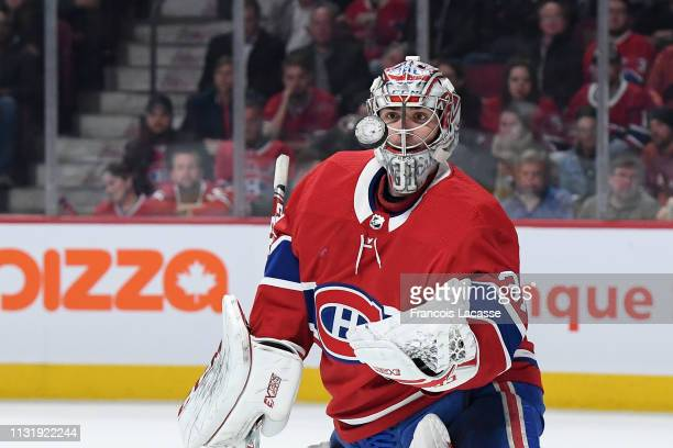 Carey Price of the Montreal Canadiens stares at flying puck after a save against the New York Islanders in the NHL game at the Bell Centre on March...