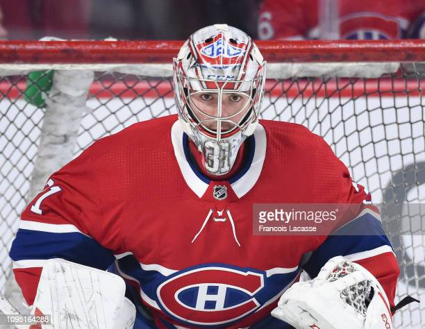 Carey Price of the Montreal Canadiens stares at the camera during the warmup prior to the NHL game against the Winnipeg Jets at the Bell Centre on...