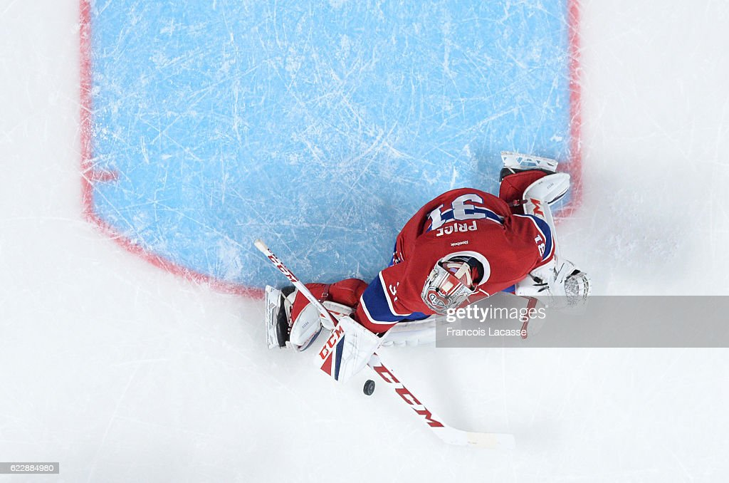 Carey Price #31 of the Montreal Canadiens stops a shot by the Detroit Red Wings in the NHL game at the Bell Centre on November 10, 2016 in Montreal, Quebec, Canada.