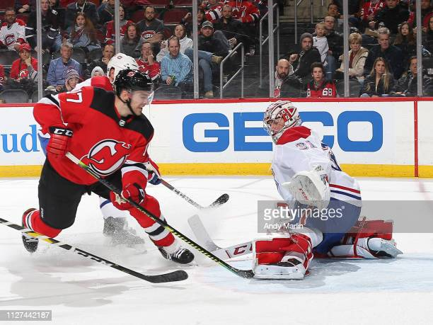 Carey Price of the Montreal Canadiens stops a shot on goal by Kenny Agostino of the New Jersey Devils during the third period at the Prudential...