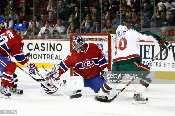 Carey Price of the Montreal Canadiens stops the puck on a shot from Marian Gaborik of the Minnesota Wild during the game at the Bell Centre on...