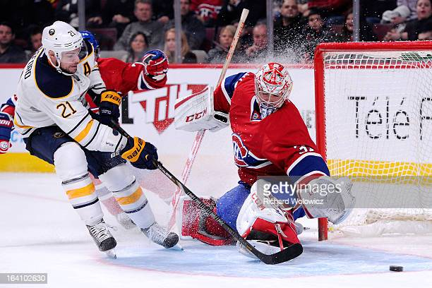 Carey Price of the Montreal Canadiens stops the puck on an attempt by Drew Stafford of the Buffalo Sabres during the NHL game at the Bell Centre on...
