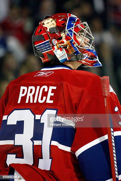 Carey Price of the Montreal Canadiens watches the Bell Centre video system during the NHL game against the Boston Bruins on December 4 2009 at the...