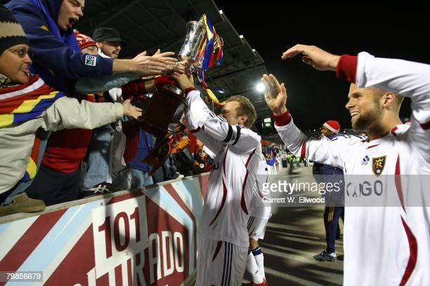 Carey Talley and Chris Wingert of Real Salt Lake share the Rocky Mountain Cup with fans after the game against the Colorado Rapids at Dick's Sporting...