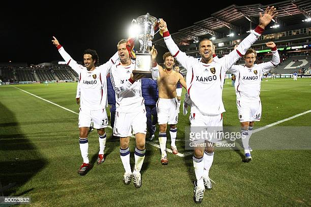 Carey Talley and Chris Wingert of Real Salt Lake show the Rocky Mountain Cup to the fans after the game against the Colorado Rapids at Dick's...