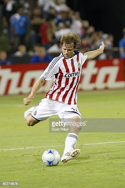 Carey Talley of Chivas USA crosses the ball against the Kansas City Wizards during the game at Community America Ballpark on August 9 2008 in Kansas...